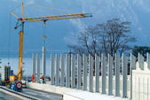 Workers during the installation of noise barriers — Stock Photo