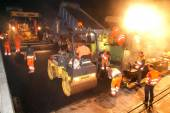 Workers and vehicles during work — ストック写真
