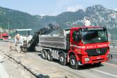 Workers and vehicles during the road milling — Stock Photo