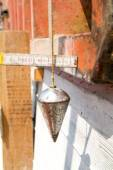 Pendulum for construction of wall — Stock Photo