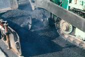 Workers and vehicles doing asphalting — Foto de Stock