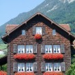 Traditional Swiss country house — Stock Photo #76876453
