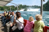 People in a tourist boat approaching the Rhine waterfalls — Stock Photo