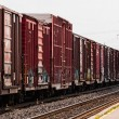 Red freight train box cars in perspective — Stock Photo #66357573