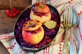 Stewed red cabbage with the stuffed apples in a metal vintage bowl  — 图库照片