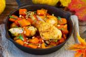 The baked chicken with pumpkin in a pig-iron frying pan  — Stock Photo