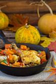 The baked chicken with pumpkin in a pig-iron frying pan  — Photo