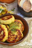 Potato patties with fried  bacon  and onions. — Stok fotoğraf
