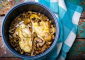 stewed chicken breast with mushrooms in the crock-pot. — Stock Photo