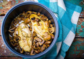 stewed chicken breast with mushrooms in the crock-pot. — Стоковое фото