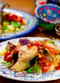 Fried mackerel with tomato sauce and couscous  — Stock Photo