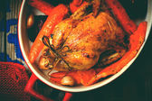 The chicken baked with root crops.  — Stock Photo