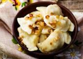 Potatoes vareniki in a ceramic bowl. — Stock Photo