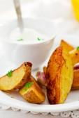 Segments of baked potato — Stock Photo