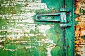Rusty metal door with hinge cracked paint — Stock Photo