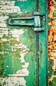 Hinge on rusty metal door with cracked paint — Stock Photo