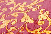 Gold flourish design. Red background. — Stock Photo