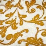 Gold flourish design. White background. — Stock Photo #73801309