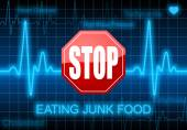 Stop eating junk food - on blue heart rate monitor — Stock Photo