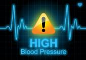 Yüksek tansiyon, kalp hızı monitörü yazılmış — Stok fotoğraf