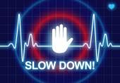 SLOW DOWN written on blue heart rate monitor — Foto de Stock