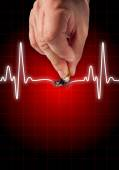 Hand putting out cigarette on heart beat line — Stock Photo