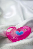 Glossy pink heart with love message — Stock Photo