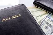 Holy Bible and money — Stockfoto