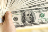 American dollars in hand — Stock Photo