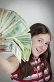 Beautiful teen girl holding US dollars — Zdjęcie stockowe
