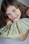 Beautiful teen girl holding US dollars — Stock Photo