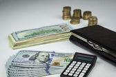 Wallet and a lot of US dollars — Stock Photo