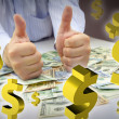 Hands with thumbs up, money and dollar signs floating — Stock Photo #57386905