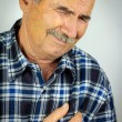 Man with chest pain — Stock Photo #60472889