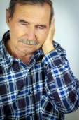 Man with pain in ear — Stock Photo