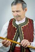 Joueur de tuyau en costume traditionnel — Photo