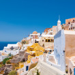 Colorful Oia village on the edge of the Santorini Caldera cliffs on the island of Thira (Santorini), Greece. — Stock Photo #54796051