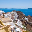 View of Oia town and the castle of Oia towards Thirassia, Thera (Santorini),Greece. — Stock Photo #54796061