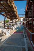 MATALA,CRETE-JULY 22: Colorful street in Matala village on July 22,2014 on the island of Crete, Greece. Matala is a village located 75 km south-west of Heraklion, Crete. — Zdjęcie stockowe