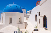 Oia Orthodox churches domes and the bell-tower. Santorini island, Greece. — Stock Photo