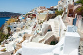 Oia carved-in buildings on the island of Thera (Santorini), Greece. — Stock Photo