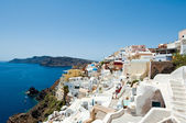 Oia town looking north towards the Therasia island on the island of Thera (Santorini), Greece. — Stock Photo
