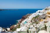 Oia village and Port of Ammoudi below on the island of Thira (Santorini), Greece. — Stock Photo