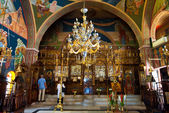 SANTORINI,OIA-JULY 28: Interior of the Church of Agia Irini on July 28,2014 in Oia town on the Santorini island, Greece. Oia is a small town on the islands of Thira (Santorini) and Therasia, Greece. — Foto Stock