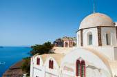 Orthodox church overlooking the caldera and the volcano. Fira, Santorini in Greece. — Stock Photo