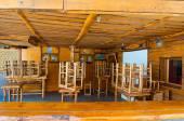 SANTORINI,FIRA-JULY 28: Wooden bar on July 28,2014 in Fira town on the Santorini island, Greece. Firá is the modern capital of the Greek Aegean island, Santorini. — ストック写真