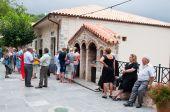 CRETE,GREECE-JULY 20:The Monastery of Kera Kardiotissa and a group of pilgrims on the island of Crete on July 28,2014.Greece. — Stock Photo