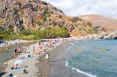 CRETE,GREECE-JULY 23:Tourists go downstairs to the Preveli Beach on July 23,2014 on Crete,Greece. The beach of Preveli is situated 40 km south of the main town and is the most idyllic beach in Crete. — Stock Photo