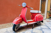 CORFU-AUGUST 22: Vespa scooter parked on Kerkyra street on August 22, 2014 on Corfu island. Greece. Vespa is an Italian brand of scooter manufactured by Piaggio. — Stock Photo
