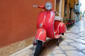 CORFU-AUGUST 22: Vespa scooter on Kerkyra street on August 22, 2014 on Corfu island. Greece. Vespa is an Italian brand of scooter manufactured by Piaggio. — Stock Photo